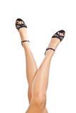 Woman legs. Crossed caucasian woman legs in heels Stock Images