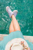 Woman legs above water on a dock Royalty Free Stock Photo