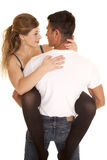 Woman legs around man holding her look at each other Stock Photo