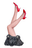 Woman legs with bag Royalty Free Stock Photos