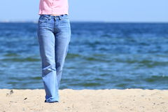 Woman legs on the beach Royalty Free Stock Photo