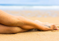 Woman legs on the beach Royalty Free Stock Photography
