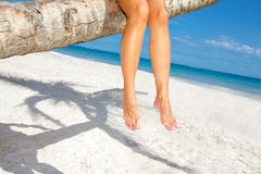Woman legs on the beach. Royalty Free Stock Photo