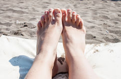 Woman legs on beach Royalty Free Stock Images