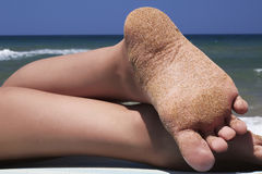 Woman legs on the beach Stock Photography