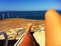 Woman legs on the beach Stock Photo