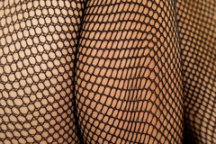 Woman legs black fishnet close calf thigh Stock Image