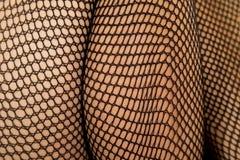 Woman legs black fishnet close calf thigh Stock Image