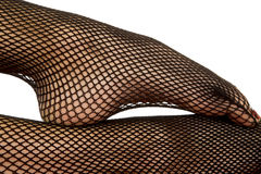 Woman legs black fishnet close foot on leg Stock Photos