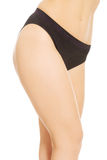Woman legs in black panties Stock Images