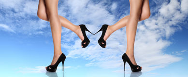 Woman legs with black shoes stiletto heel concept of lightness Royalty Free Stock Photo