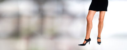 Woman legs with black short dress Royalty Free Stock Photos