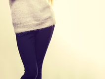 Woman legs in black trousers and furry jumper Royalty Free Stock Photo