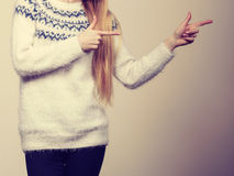 Woman legs in black trousers and furry jumper Stock Photo