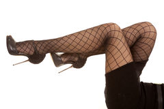Woman legs blacknet up Stock Photography