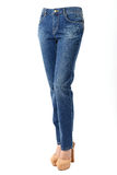 Woman legs in blue jeans Stock Photo
