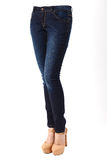 Woman legs in blue jeans Royalty Free Stock Photography