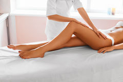 Woman legs. Body care. Girl getting leg massage treatment in spa Royalty Free Stock Photos