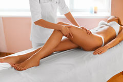 Woman legs. Body care. Girl getting leg massage treatment in spa Stock Photo