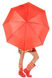 Woman legs and boots show under umbrella Stock Photo