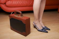 Woman legs & briefcase Royalty Free Stock Photos