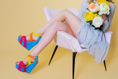 Woman legs and bright fashion platform shoes Stock Image