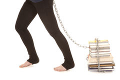 Woman legs chain stack of books Stock Image