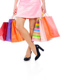 Woman legs with colorful shopping bags Stock Image