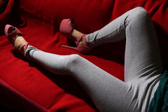 Woman legs on the couch Royalty Free Stock Photography