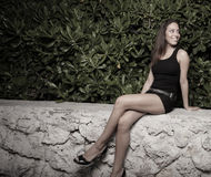 Woman with legs crossed Stock Photography