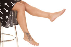 Woman legs crosses tattoo sit Royalty Free Stock Image