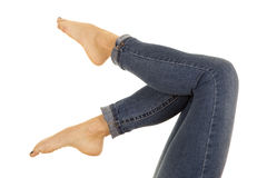 Woman legs in denim pants barefoot up Royalty Free Stock Images