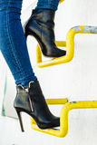 Woman legs in denim pants heels shoes outdoor Royalty Free Stock Photo