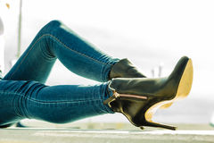 Woman legs in denim pants heels shoes outdoor Royalty Free Stock Images
