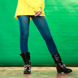 Woman legs in denim trousers boots Royalty Free Stock Images