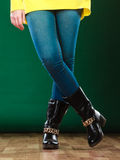 Woman legs in denim trousers boots Stock Image