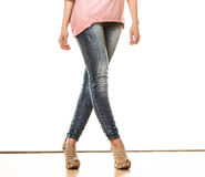 Woman legs in denim trousers high heels shoes Royalty Free Stock Photography