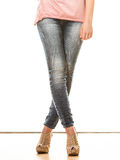 Woman legs in denim trousers high heels shoes Royalty Free Stock Images