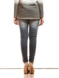 Woman legs in denim trousers high heels shoes Stock Photo