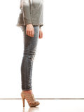 Woman legs in denim trousers high heels shoes Stock Images