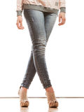 Woman legs in denim trousers high heels shoes Royalty Free Stock Photos