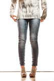 Woman legs in denim trousers high heels shoes Royalty Free Stock Image