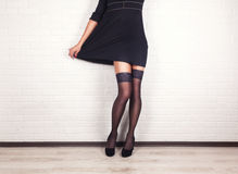 Woman legs in elegant black high heel shoes Royalty Free Stock Photography