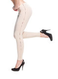 Woman legs in fawn leggins and black shoes Stock Images
