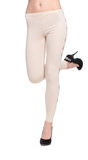 Woman legs in fawn leggins and black shoes Stock Photo