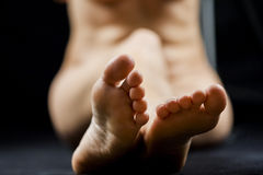 Woman legs and feet with dark background Stock Image