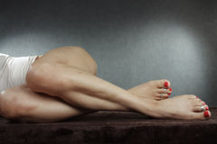 Woman legs and feet over grey background Stock Photo