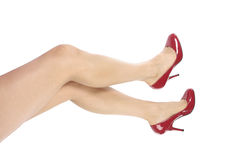 woman legs and feet and red heels over white Royalty Free Stock Photos