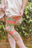 Woman Legs with Floral Print Leggings Royalty Free Stock Images