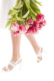 Woman legs and flowers Stock Images